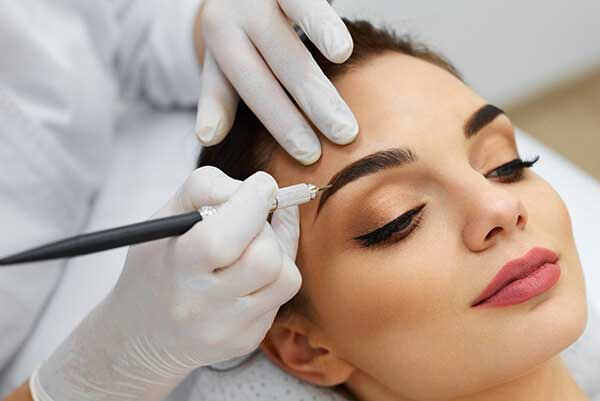 Lady having microblading applied