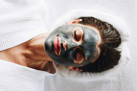 Woman using enzyme peel face mask
