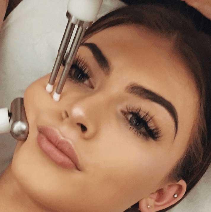 Woman having a CACI Facial