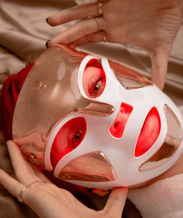 Woman with Red Light Mask