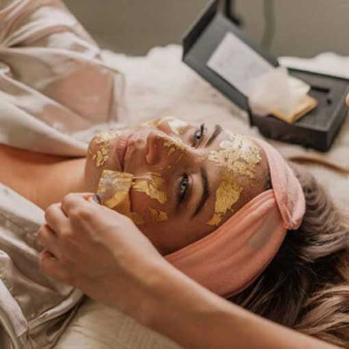 24k gold facial being peeled off a beautiful woman's face