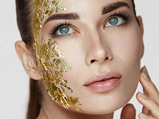 A beautiful woman with a 24k gold foil facial