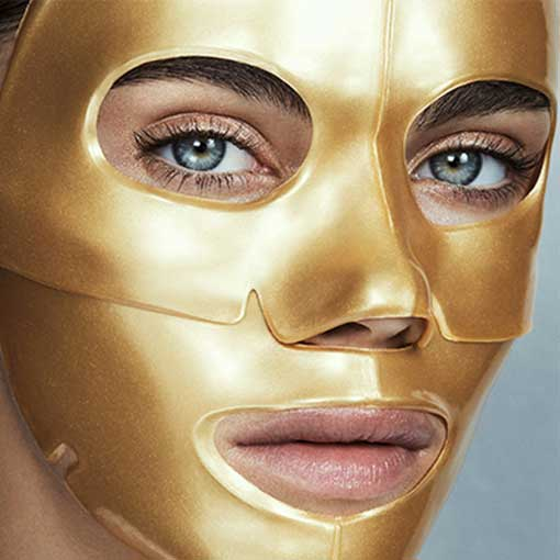A beautiful woman's face covered in gold