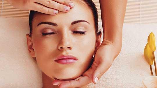 Woman receiving an Indian head massage